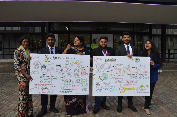 Commonwealth youth network holding envirovisuals boards